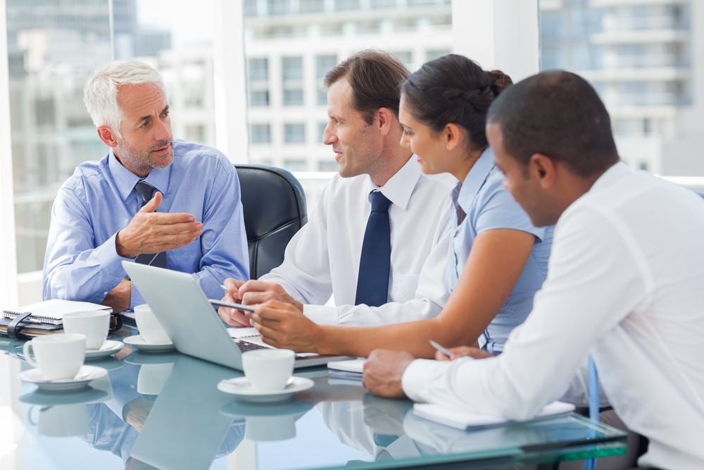 Group of business people brainstorming together in the meeting room-1